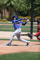 Hector Olivera, a native of Cuba signed by the Los Angeles Dodgers to a 6-year, $62.5 million contract, hits a homerun in his final at-bat of his first extended spring training game for the Dodgers against the Cincinnati Reds at Camelback Ranch on May 28, 2015 in Glendale, Arizona (Bill Mitchell)