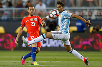 Action photo during the match Argentina vs Chile at Levis Stadium Copa America Centenario 2016. ---Foto  de accion durante el partido Argentina vs Chiler, En el Estadio de la Universidad de Phoenix, Partido Correspondiante al Grupo - D -  de la Copa America Centenario USA 2016, en la foto (I)-(D) Marcelo Diaz, <br /> --- 06/06/2016/MEXSPORT/PHOTOSPORT/ Andres Pina