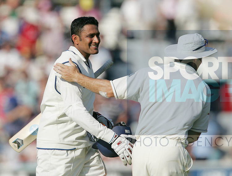 England's Michael Vaughan congraulates India's Anil Kumble. .Pic SPORTIMAGE/David Klein
