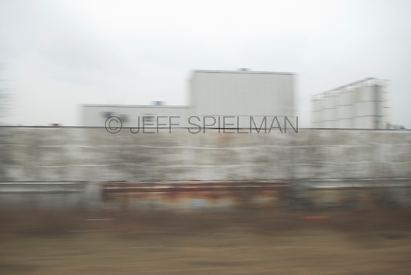 Industrial Building in Central New Jersey Viewed from the Window of a Moving New Jersey Transit Passenger Train, New Jersey, USA