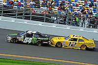 Kyle Busch (#54) and Sam Hornish, Jr. (#12)