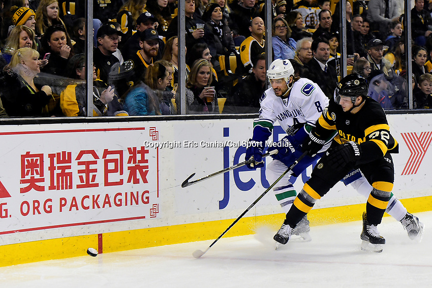 February 11, 2017: Boston Bruins center Frank Vatrano (72) and Vancouver Canucks defenseman Christopher Tanev (8) battle for the puck during the National Hockey League game between the Vancouver Canucks and the Boston Bruins held at TD Garden, in Boston, Mass. Boston defeats Vancouver 4-3 in regulation time. Eric Canha/CSM