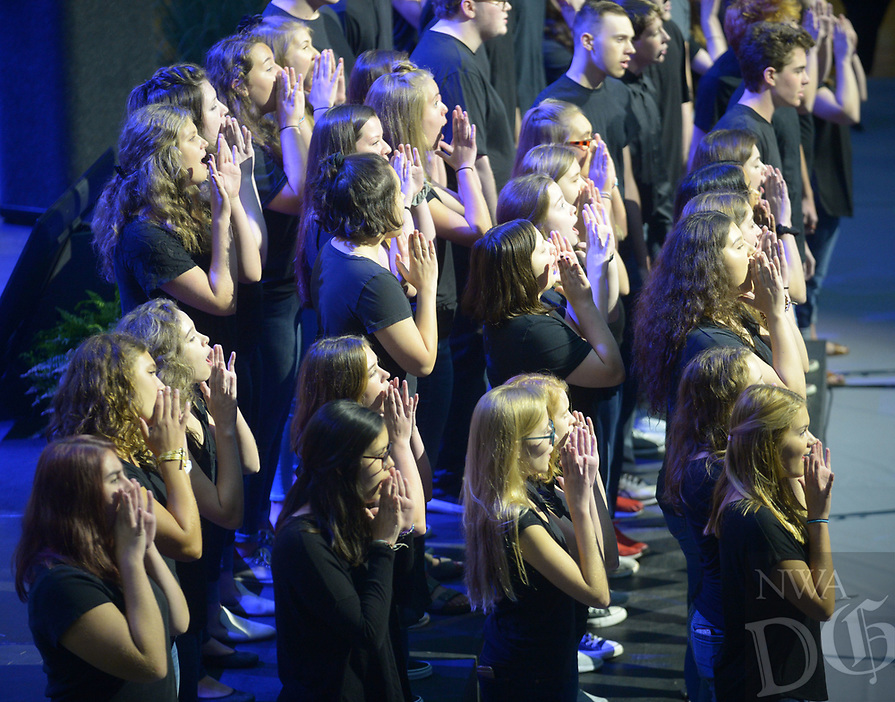 NWA Democrat-Gazette/ANDY SHUPE<br /> Friday, Aug. 10, 2018, during Fayetteville Public Schools annual Convocation ceremony in Bulldog Arena on the Fayetteville High School campus. The event, which features performances by a combined choir and the high school band as well as awards and presentations, serves as a kickoff to the school year which begins Monday.