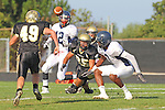 Palos Verdes CA 10/22/10 - Ivan McLennoan (C) (Leuzinger #3), Tommy Webster (Peninsula #49), Logan Okuda (Peninsula #25) and Laron Barnes (C) (Leuzinger #12) in action during the Leuzinger - Peninsula varsity football game at Palos Verdes Peninsula High School.