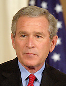 Washington, D.C. - June 24, 2005 -- United States President George W. Bush listens to a question as he holds a joint press conference with Prime Minister Ibrahim al-Jaafari of Iraq in the East Room at the White House in Washington, D.C. on June 24, 2005.  They discussed the re-building of Iraq and refused to give a time-table for the withdrawal of United States forces.<br /> Credit: Ron Sachs / CNP