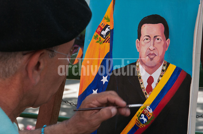 Venezuela: Caracas,22/02/12 .Manuel Gonzalez,an street painter ,retouching a portrait of President Hugo Chavez wearing the presidential sash, a few blocks from the Miraflores presidential palace in Caracas...Carlos Hernandez/Archivolatino