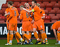 JOHNNY RUSSELL IS CONGRATULATED AFTER HE SCORES DUNDEE UTD'S THIRD