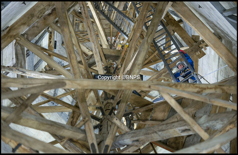 BNPS.co.uk (01202 558833)<br /> Pic: TomWren/BNPS<br /> <br /> Ecclesiastical carpenter Richard Pike heads up one of ten ladders to reach the weather door.<br /> <br /> How many men does it take to change a lightbulb... at the top of Britain's tallest spire.<br /> <br /> When your office is Salisbury Cathedral the simple task of changing a light bulb involves four men, a 404ft climb and takes three hours.<br /> <br /> Ecclesiastical carpenter Richard Pike needed a head for heights when he joined Gary Price, who is in charge of conservation, to make the daring ascent with two rope specialists to ensure their safety. <br /> <br /> Despite working at the cathedral for 27 years, it was the first time Richard has ever made the hair-raising climb.