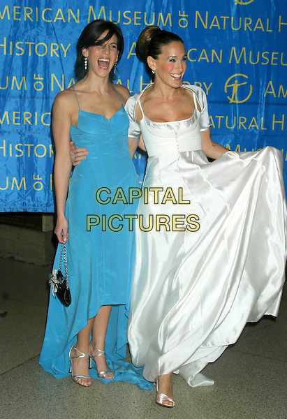 JESSICA SEINFELD & SARAH JESSICA PARKER.The Museum Ball 2004, American Museum of Natural History, New York City..November 17, 2004 .full length, white silk satin dress, flowing, blue dress, gesture, laughing arms arond waist.www.capitalpictures.com.sales@capitalpictures.com.© Capital Pictures
