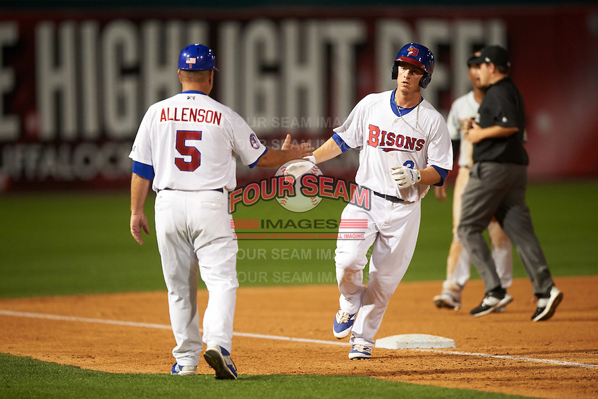Buffalo Bisons manager Gary Allenson (5) congratulates Matt Dominguez (3) after hitting a home run during a game against the Norfolk Tides on July 18, 2016 at Coca-Cola Field in Buffalo, New York.  Norfolk defeated Buffalo 11-8.  (Mike Janes/Four Seam Images)