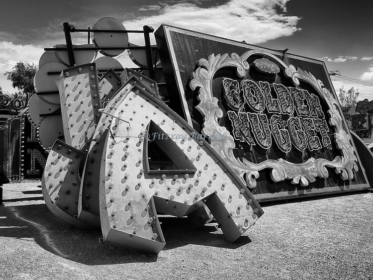A blast from the past retro neon hotel sign collecting dust in Las Vegas Nevada March 26, 2014. ©Fitzroy Barrett