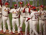 Cardinals manager Mike Matheny gets high-fives from his players at the beginning of the game during introductions of the teams.