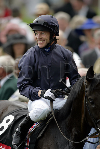 3 June 2005: Irish Jockey Kieren Fallon returns smiling after his victory on YEATS in The Vodafone Coronation Cup at Epsom Photo: Glyn Kirk/Actionplus....050603 joy celebrate celebration