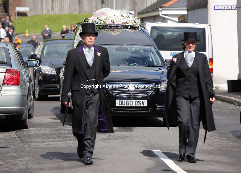 """COPY BY TOM BEDFORD<br />Pictured: The funeral cortege leaves after the service, the Jerusalem Baptist Chapel in Merthyr Tydfil, Wales, UK. Friday 18 August 2017<br />Re: The funeral of a toddler who died after a parked Range Rover's brakes failed and it hit a garden wall which fell on top of her will be held today at Jerusalem Baptist Chapel in Merthyr Tydfil.<br />One year old Pearl Melody Black and her eight-month-old brother were taken to hospital after the incident in south Wales.<br />Pearl's family, father Paul who is The Voice contestant and mum Gemma have said she was """"as bright as the stars""""."""