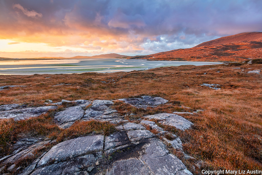 Isle of Lewis and Harris, Scotland: Boulders set in in the machair with the broad expanse of Luskentyre beach at sunset on the Isle of Harris