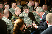 Washington, D.C. - September 5, 2006 -- United States President George W. Bush signs autographs for soldiers following his remarks on the Global War on Terror at the Capital Hilton Hotel in Washington, D.C. on September 5, 2006.<br /> Credit: Ron Sachs - Pool via CNP