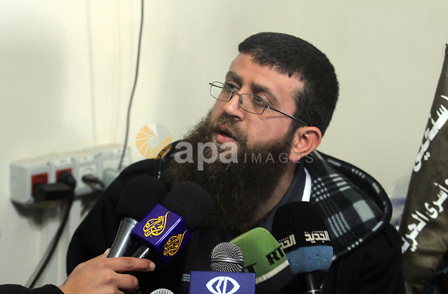 Khader Adnan, a senior member of Islamic Jihad and former Palestinian prisoner who was on hunger strike, speaks to media during a sit-in in the Red Cross headquarter office in solidarity with hunger strike prisoner held by Israel, and demanding an end to detentions without trial in the West Bank city of Ramallah on February 13, 2013. Photo by Issam Rimawi