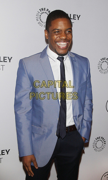 Jon Michael Hill<br /> at  The Paley Center for Media Presents PaleyFest: Made in NY &quot;Elementary&quot; at the Paley Center for Media  in New York City, USA, <br /> October 5th, 2013.<br /> half length blue jacket suit tie black hand in pocket smiling <br /> CAP/MPI/RW<br /> &copy;RW/ MediaPunch/Capital Pictures