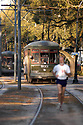 A jogger travels along the St. Charles Streetcar line, Friday, March 26, 2005.<br /> (Cheryl Gerber Photo)complete streets