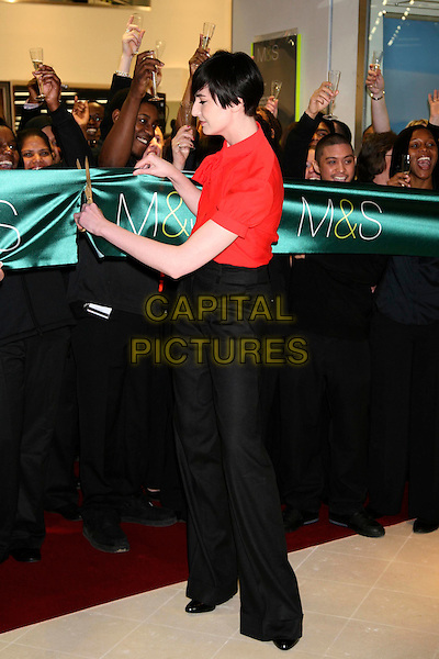 ERIN O'CONNOR.Opens the new M&S store at Colliers Wood, South London, England..May 1st, 2008.M & S Marks & Spencer full length red blouse black trousers cutting ribbon gesture .CAP/DS.©Dudley Smith/Capital Pictures