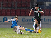 16th March 2018, McDiarmid Park, Perth, Scotland; Scottish Premier League football, St Johnstone versus Hibernian; Murray Davidson of St Johnstone slides in on John McGinn of Hibernian