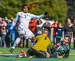 3 October 2015: Binghamton University Bearcat Midfielder Kevin Flesch, a Freshman from Munich, Germany, helps his goalkeeper from a shot on goal by University of Vermont Catamount Forward Brian Wright, a Junior from Ajax, Ontario, during game action at Virtue Field in Burlington, Vermont. The Bearcats held on to defeat the Catamounts 2-1 in America East conference play. Mandatory Credit: Ed Wolfstein Photo *** RAW (NEF) Image File Available ***
