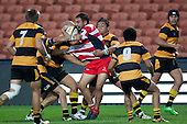 Ross Turnbull gets swamped by the Bombay defenders. Counties Manukau Premier Club Rugby game played between Karaka and Bombay at Waikato Stadium as a curtain raiser to the Chiefs vs Highlanders Super 15 rugby match on May 7th 2011. Karaka won the game 19 - 17.