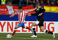 Atletico de Madrid's Eduardo Salvio (l) and Lazio's Andre Dias during Europa League match.February 23,2012. (ALTERPHOTOS/Acero) .Atletico Madrid Lazio Europa League.Italy Only