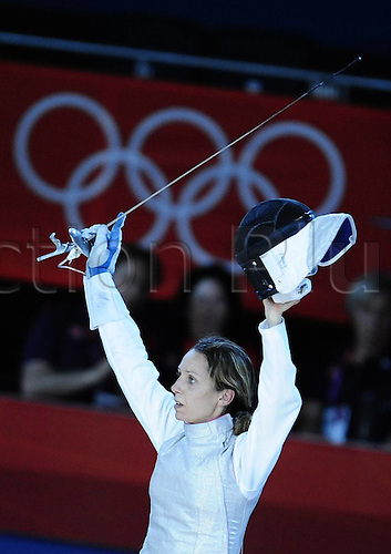 28.07.2012. London, England. Excel Centre. Valentina Vezzali of Italy Celebrates After Winning womens foil Individual Bronze Medal Match of Fencing Against Nam Hyun Hee of South Korea AT The London 2012 Olympic Games in London Valentina Vezzali took The Bronze Medal After Beating Nam Hyun Hee 13 12