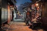 Street of shops of the iron and copper workers at night in the old town of Sarajevo, Bosnia and Herzegovina. The city was founded by the Ottomans in 1461. Picture by Manuel Cohen