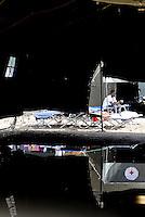 Roma, 12 Agosto 2015<br /> Tendopoli allestita dalla Croce Rossa nei pressi della stazione ferroviaria Tiburtina per migranti. Centinaia di migranti provenienti da Etiopia, Somalia ed Eritrea, tutti arrivati negli ultimi mesi dalla Libia con i barconi e portati in Italia dopo essere stati salvati in mare.<br /> Tende allagate dopo le pioggie.<br /> Camp set-up by the Red Cross close to the Tiburtina train station for migrants. Hundreds of migrants mainly from Ethiopia, Somalia and Eritrea, all arrived in recent months from Libya with the barges and taken to Italy after being rescued at sea.