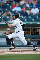 Daniel Palka (22) of the Charlotte Knights follows through on his swing against the Toledo Mud Hens at BB&T BallPark on April 23, 2019 in Charlotte, North Carolina. The Knights defeated the Mud Hens 11-9 in 10 innings. (Brian Westerholt/Four Seam Images)