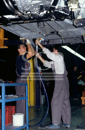 Varna, Bulgaria. Two workers working on a new car in Rodacar car factory.