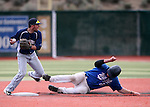 Wildcats' Corey Pool tries to break up a double play against Utah State University Eastern at Western Nevada College in Carson City, Nev., on Saturday, April 25, 2015. <br /> Photo by Cathleen Allison