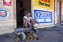 Publican and his dogs in front of hotel, Croydon, Queensland
