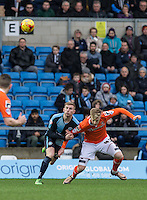 Jason McCarthy of Wycombe Wanderers keeps a hold off Joe Pigott of Luton Town during the Sky Bet League 2 match between Wycombe Wanderers and Luton Town at Adams Park, High Wycombe, England on 6 February 2016. Photo by Andy Rowland.