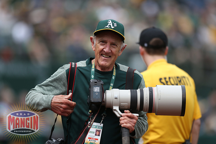 OAKLAND, CA - APRIL 5:  Oakland Athletics team photographer Michael Zagaris works during the game against the Texas Rangers at the Oakland Coliseum on Thursday, April 5, 2018 in Oakland, California. (Photo by Brad Mangin)