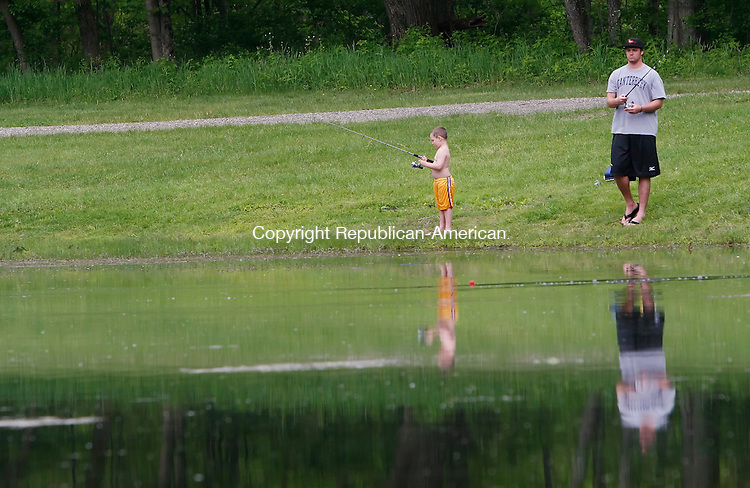ROXBURY, CT, 05/16/09- 051609BZ02- Sebastian Ruscoe, 5, of Litchfield, and his uncle Kelly Ruscoe, of Roxbury,  take part in the annual Roxbury Fishing derby at the Indian River Road Preserve Saturday morning.<br /> Jamison C. Bazinet Republican-American