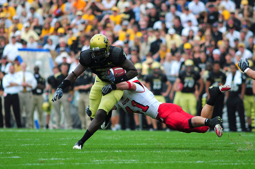 06 September 08: Colorado tailback Darrell Scott (2) takes an open field tackle from Eastern Washington linebacker Zach Johnson. Colorado Buffaloes defeated the Eastern Washington 31-24 at Folsom Field in Boulder, Colorado. FOR EDITORIAL USE ONLY
