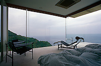 The glass walls in the master bedroom afford dramatic views over the peninsula and the sea of Japan