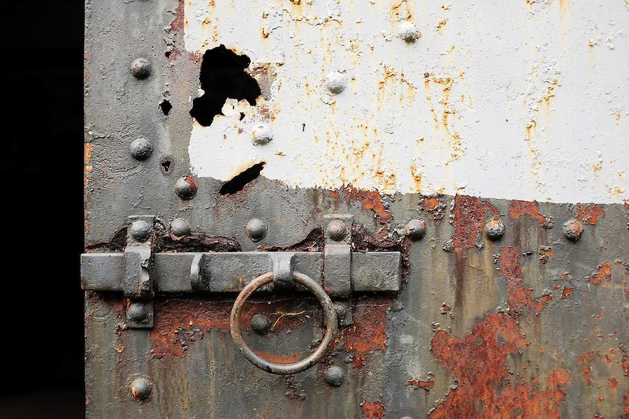 Rusty grey steel door in concrete bunker, Artillery Hill, Fort Worden State Park, Port Townsend, Washington, USA
