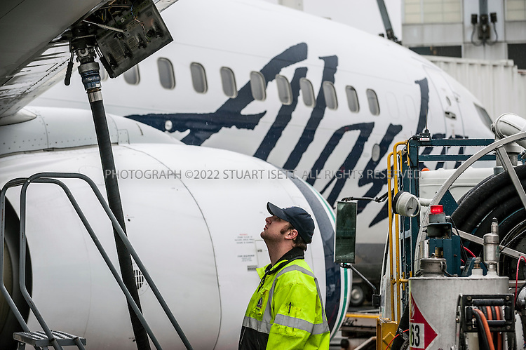 "3/14/2012--Seattle, WA, USA..At Seattle's Seatac Airport, Jeremy Summers loads fuel into one of Alaska Airline's Boeing 737s. Alaska Airlines is using Next Generation (NextGen) air traffic control systems to help lower fuel costs through more efficient flight paths and descents in airports...SOURCE WIKIPEDIA: The Next Generation Air Transportation System (NextGen) is the name given to a new National Airspace System due for implementation across the United States in stages between 2012 and 2025 The Next Generation Air Transportation System (NextGen) proposes to transform Americas air traffic control system from an aging ground-based system to a satellite-based system. NextGen GPS technology will be used to shorten routes, save time and fuel, reduce traffic delays, increase capacity, and permit controllers to monitor and manage aircraft with greater safety margins. To implement this the Federal Aviation Administration (FAA) will undertake a wide-ranging transformation of the entire United States air transportation system. This transformation has the aim of reducing gridlock, both in the sky and at the airports. In 2003, The United States Congress established the Joint Planning and Development Office (JPDO) to plan and coordinate the development of the Next Generation Air Transportation System...SOURCE: ALASKA AIRLINES WEBSITE: Alaska Airlines pioneered the development of Required Navigation Performance flight guidance technology (RNP) in the mid-1990s. ""RNP"" technology, uses a sophisticated global positioning system, and allows aircraft to fly more direct routes and at lower minimum elevations with pinpoint accuracy. Alaska Airlines remains the only domestic carrier with a 100% RNP-equipped fleet and fully-trained crews. Alaska Airlines is working to further reduce aircraft greenhouse gas emissions and noise in the Puget Sound region. By using RNP and new procedures, aircraft can fly shorter, continuous descent approaches instead of traditional stair-step landing pat"