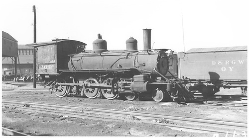 Engine #169 in storage.  Tender of rotary OY in photo.<br /> D&amp;RGW  Alamosa, CO  Taken by Rogers, Donald E. A. - 1939