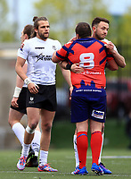 TORONTO, ON - MAY 06:  Ryan Brierley #27 of Toronto Wolfpack hugs Josh Scott #8 of Oxford RLFC following a Kingstone Press League 1 match at Lamport Stadium on May 6, 2017 in Toronto, Canada.  (Photo by Vaughn Ridley/SWpix.com)