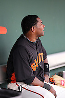 Miguel Tejada #10 of the San Francisco Giants watches from the dugout during the game against the Arizona Diamondbacks in the first spring training game of the season at Scottsdale Stadium on February 25, 2011  in Scottsdale, Arizona. .Photo by:  Bill Mitchell/Four Seam Images.