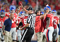 NWA Democrat-Gazette/CHARLIE KAIJO Ole Miss head coach Matt Luke gives praise to Ole Miss defensive end Quentin Bivens (94) during the first half of a football game, Saturday, September 7, 2019 at Vaught-Hemingway Stadium in Oxford, Miss.