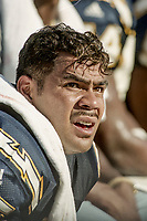 MIAMI, FL - DEC 19, 1999:  Linebacker Junior Seau, #55, is shown on the sidelines as the Miami Dolphins defeat his San Diego Chargers 12-9 at Joe Robbie Stadium, in Miami, FL. (Photo by Brian Cleary/www.bcpix.com)