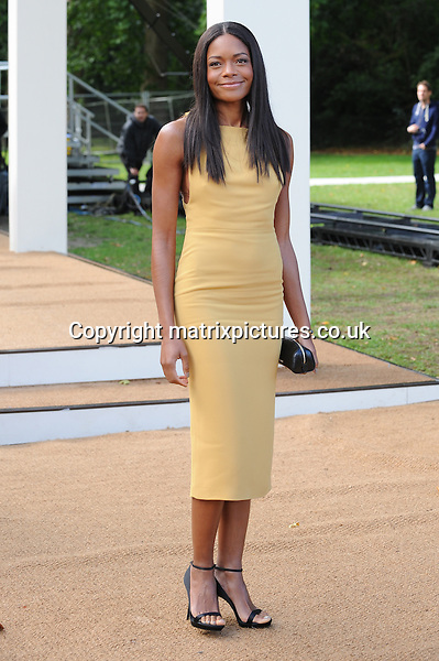 NON EXCLUSIVE PICTURE: PAUL TREADWAY / MATRIXPICTURES.CO.UK<br /> PLEASE CREDIT ALL USES<br /> <br /> WORLD RIGHTS<br /> <br /> British actress Naomie Harris attends the Burberry Prorsum catwalk show during London Fashion Week S/S 2014, at Kensington Gardens, in London.<br /> <br /> SEPTEMBER 16th 2013<br /> <br /> REF: PTY 136149