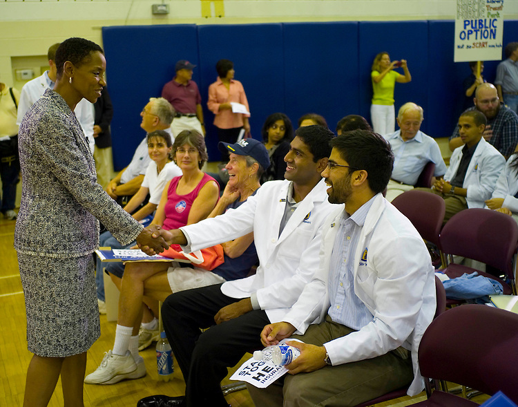 GERMANTOWN, MD - August 25: Johns Hopkins medical students Jathin Bandari and Shiv Gandhi meet Rep. Donna Edwards at the beginning of a town hall meeting in Germantown, Md., hosted by Rep. Donna Edwards, D-Md., on healthcare legislation before the U.S. Congress. Bandari and Gandhi support a public option. (Photo by Scott J. Ferrell/Congressional Quarterly)