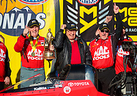 Feb 11, 2019; Pomona, CA, USA; NHRA top fuel driver Doug Kalitta (left) celebrates with team owner Connie Kalitta (center) and crew chief Rob Flynn after winning the Winternationals at Auto Club Raceway at Pomona. Mandatory Credit: Mark J. Rebilas-USA TODAY Sports